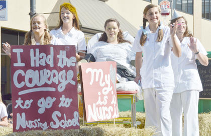 "CU School of Nursing students show they have the ""courage"" to go to nursing school during Saturday's homecoming parade. This year's theme was ""There's NO place like homecoming,"" after ""The Wizard of Oz."""