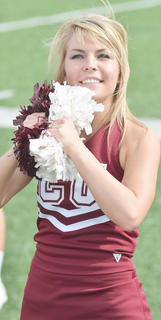 CU cheerleader Rachel Clements of Campbellsville leads the crowd in a cheer during Saturday's football game.