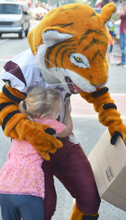 CU's mascot, Clawz, greets children during Saturday's homecoming parade. Here, Calleigh Carter, 6, gets some candy from Clawz. Carter is the granddaughter of Dr. and Mrs. John Mark Carter of Campbellsville and the daughter of Caroline Carter. Dr. Carter is a professor of human performance at CU.