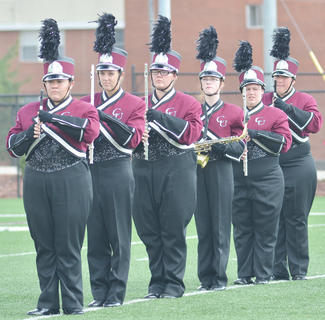 CU Tiger Marching Band woodwind players stand at attending during Saturday's halftime show performance.