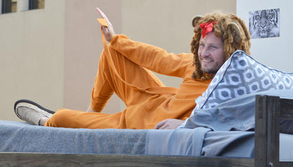 "Jason Lawson, residence director at CU's South Hall East, dresses as a cowardly lion atop the Residence Life float during Saturday's homecoming parade. This year's theme was ""There's NO place like homecoming,"" after ""The Wizard of Oz."" The Residence Life float won first place in this year's contest."
