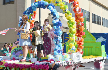"""CU international students ride on their float during Saturday's homecoming parade. They proclaimed on the float that they've found their """"second home"""" at CU."""