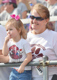 Teresa Elmore, director of Career Services at CU, cheers for the CU Tigers during Saturday's football game with her granddaughter, Lily. They are both of Campbellsville.