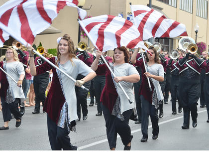 CU Tiger Marching Band color guard members perform during Saturday's homecoming parade.