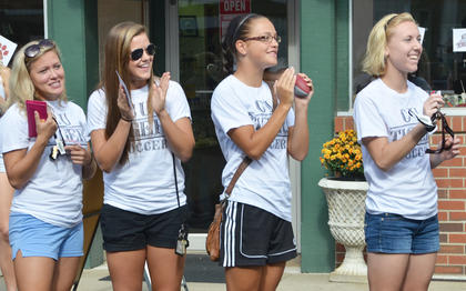 CU soccer players cheer during Saturday's homecoming parade.CU Tiger Marching Band trumpet player Saori Katoka of Japan stands at attention during Saturday's halftime show.