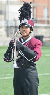 CU Tiger Marching Band trumpet player Saori Katoka of Japan stands at attention during Saturday's halftime show.