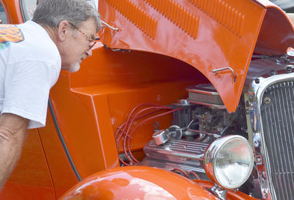 Billy Cruse of Magnolia looks at Campbellsville resident Wayne Underwood's 1993 Ford Coupe. Cruse was one of nearly 130 people who entered their classic cars into the annual CU homecoming car show. He owns a 1955 Chevrolet.