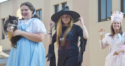 """From left, CU students Katy Johnson and Chelsea Carpenter and Johnson's mom, Pat Doolin, dress the part atop the Student Government Association float during this year's homecoming parade. This year's homecoming theme was """"There's NO place like homecoming,"""" after """"The Wizard of Oz."""""""