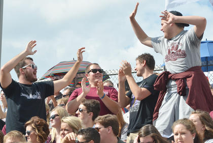 Tiger football fans cheer after their team scored its first touchdown on Saturday. The football team defeated Kentucky Christian University at a final score of 23-6.