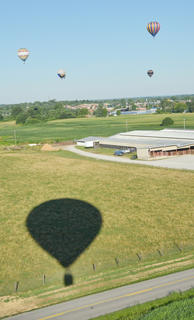 Hot air balloonists came to Campbellsville last week to help Taylor County residents celebrate the Fourth of July. They lit their balloons on Thursday for a glow and took off Friday morning for residents to watch. Some rides were also given on Saturday morning. The view from the air provided an opportunity to see an aerial view of Campbellsville, as shown above.