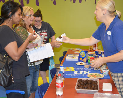 Angie Freeman, Expanded Foods & Nutrition program assistant at the Taylor County Extension Office, shows how to make a healthy pumpkin brownie snack.