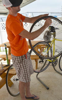 Robert Turpin of Campbellsville demonstrates how to repair a flat bicycle tire.