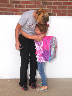 Taylor County Elementary School kindergartener Arabella Schutt has a hug for Jennifer Gabehart as she arrives at school.