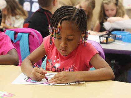 Campbellsville Elementary School kindergartener Kadence Ford colors a picture.