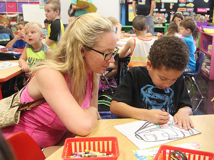 Bryant Mayo, a 5-year-old kindergartener at Campbellsville Elementary School, colors a picture while his mom, Ashley Huff, watches.