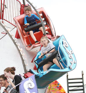 These young riders enjoyed some action on the midway at the fair Saturday.