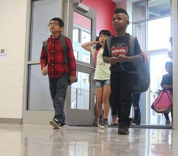 Students make their way into Taylor County Primary Center on the first day of school.