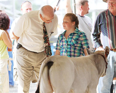 Breanna Sharp talks about her cow at the 4-H cattle show Saturday at the Taylor County Fair.