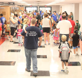 The halls are bustling with students and parents on the first day of school.