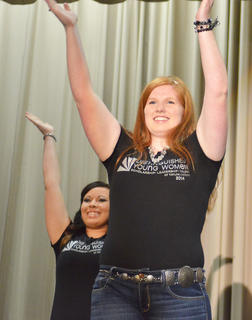 Emily Haley, who was named second runner-up, performs a routine during the opening number of the competition. In back is Chelsea Duplantis.