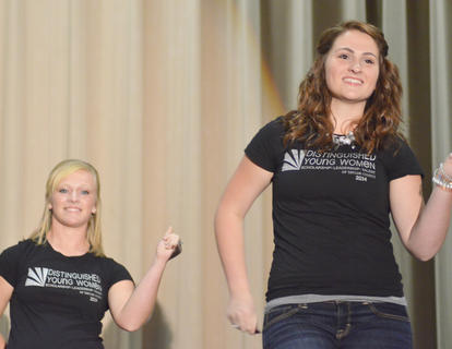 Mollie Williams, at right, performs the opening routine at Saturday's competition. At left is Kori Richerson.