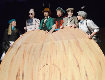 Above, from left, Jane Palagi plays Spider, Nicholas McCann portrays Earthworm, Andy O'Daniel is Grasshopper, Shelby Hayden is Ladybird, Ally Howard is James and Alexis Hayden plays Centipede as they ride atop a giant peach.