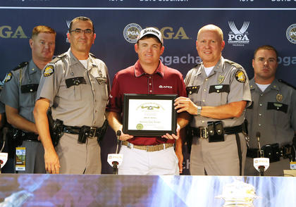 Campbellsville native J.B. Holmes was named an honorary Kentucky State Trooper on Tuesday at the PGA Championship at Valhalla Golf Club in Louisville. The honor was bestowed upon Holmes for his support of Trooper Island Camp, which is located at Dale Hollow Lake and helps children from across the state. The camp operates with no taxpayer funds. Pictured with Holmes are Trooper First Class Billy Gregory, left, a Campbellsville native who serves as public affairs officer of Post 15 Columbia, and Rodney Brewer, commissioner of Kentucky State Police.