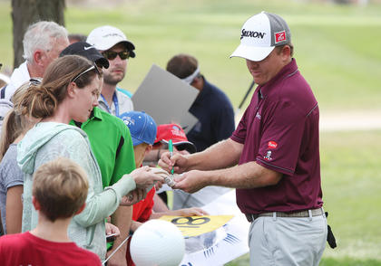 Campbellsville native J.B. Holmes signs autographs for fans during a practice round at the PGA Championship at Valhalla Golf Club in Louisville on Tuesday afternoon.