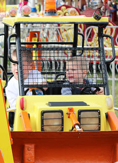 Brady Cook, left, and brother Bentley drive a backhoe on the Kids at Work Ride.