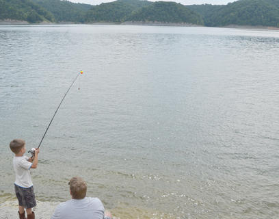 Chase Whitley, 5, of Campbellsville, casts his line as his dad, Charles, watches.