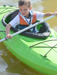Lucas Mattingly, 6, of Lebanon, takes his turn in a kayak.