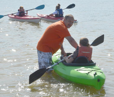 Greg Tungate of Campbellsville helps children learn to kayak.