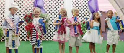 Winners of the Miss and Mister Taylor County Fair pageant are, from left, winners Ella Grace Owens and Cross William Watson, first runners-up Haley Mae Curtsinger and Ezra Colton Alexandra Curtsinger and second runner-up Donzale Al'Leigh Ennis and Jace Miller.