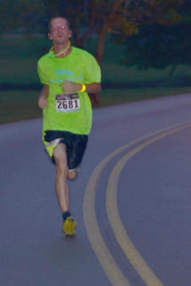 James Heath makes sure he glows in the dark as he finishes the race.