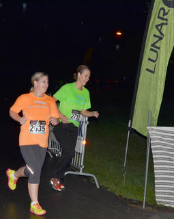 Chris Dudgeon, at left, and Tammi Roution run together as they finish the race.