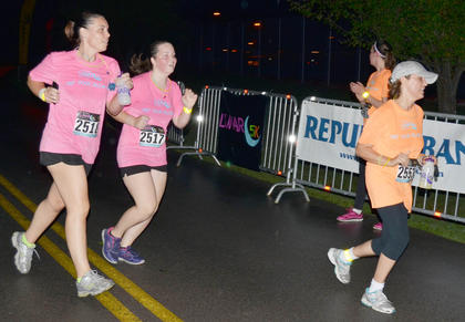 From left, Julie Spanks, Susan Spanks and Simona Boborodea finish the race.