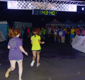 Participants cheer as racers finish the 5K race.