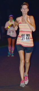 Stacie Lay runs toward the finish line.