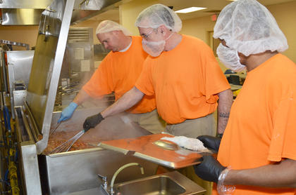Inmates cook spaghetti and meatballs for lunch. Inmates spend their time doing many jobs at the jail, from laundry to serving lunch to cleaning.