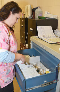 Abby Cash sorts inmates' medications.