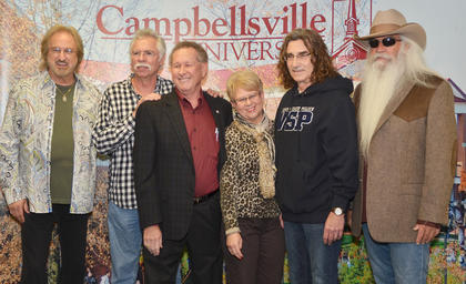 Campbellsville residents Dr. Frank and Shirley Cheatham pose for a photo with The Oak Ridge Boys during a meet and greet before Monday's concert.