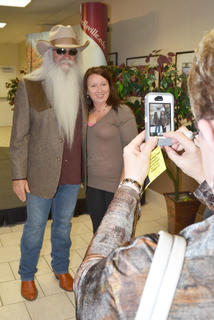 Campbellsville resident Anita Rodgers takes a photo of a fan with William Lee Golden of The Oak Ridge Boys during a meet and greet before Monday's concert.
