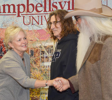 Campbellsville resident Dr. Beverly Ennis greets William Lee Golden of The Oak Ridge Boys during a meet and greet before Monday's concert.
