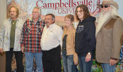 Campbellsville residents Dan and Linda Hayes pose for a photo with The Oak Ridge Boys during a meet and greet before Monday's concert.