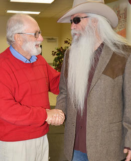 Campbellsville resident Dan Flanagan meets William Lee Golden of The Oak Ridge Boys during a meet and greet before Monday's concert.