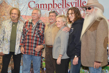 Campbellsville residents Larry and Dr. Beverly Ennis pose for a photo with The Oak Ridge Boys during a meet and greet before Monday's concert.