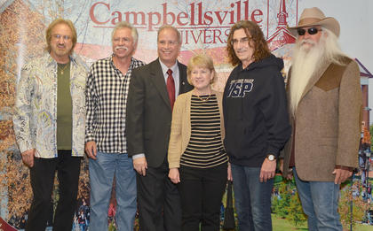 Campbellsville University President Dr. Michael V. Carter and his wife, Debbie, pose for a photo with The Oak Ridge Boys during a meet and greet before Monday's concert.