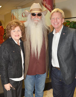 Campbellsville residents Dr. Ted and Sheri Taylor pose for a photo with William Lee Golden of The Oak Ridge Boys during a meet and greet before Monday's concert.