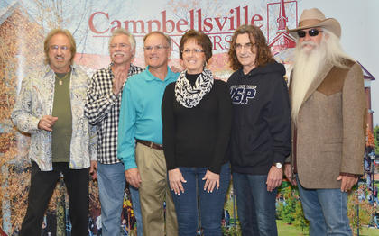 Campbellsville residents David Alan and Angie Newton pose for a photo with The Oak Ridge Boys during a meet and greet before Monday's concert.