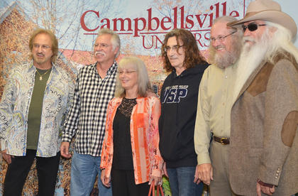 Campbellsville residents pose for a photo with The Oak Ridge Boys during a meet and greet before Monday's concert.